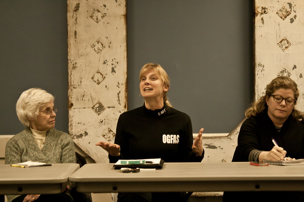 Karen Adams (center) describes the fund-raising campaign. Listening are Carol Woidt (left) of OG Beautification and Mary Ellen Tellefsen of the Chamber of Commerce.