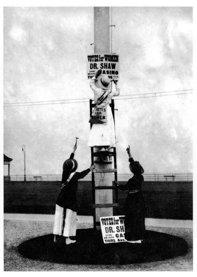 Suffragists put up a poster in Long Branch. Joe Czachowski 2010 fromLibraryof Congress; Remembering the Jersey Shoere 1915