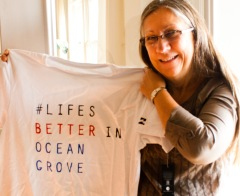 """Carol Whilden with her tee shirt from """"down under."""" Photo by Mary Walton"""