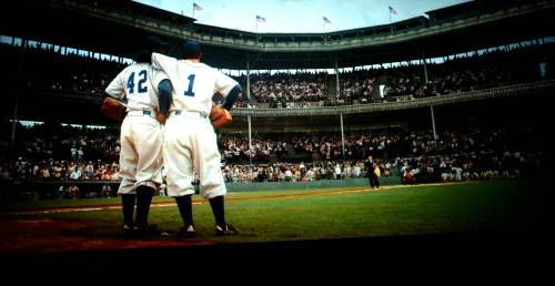 This is one of the most captivating moments in baseball history. With the crowds screaming racial slurs, Pew Wee Reese, the Dodger shortstop put his arm around JR and just stood there with him until the noise quieted.