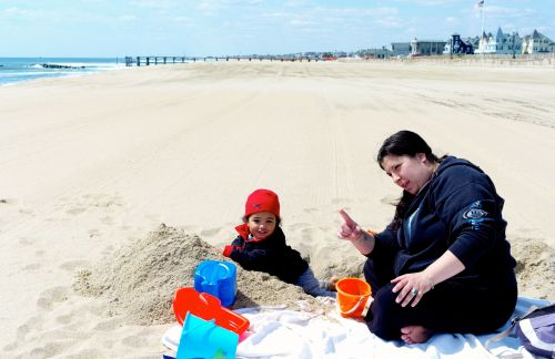 "Anthony Baldwin and Dana Perzel enjoy a huge sandbox at the OG beach.  ""It's beautiful"" says Dana from Neptune."
