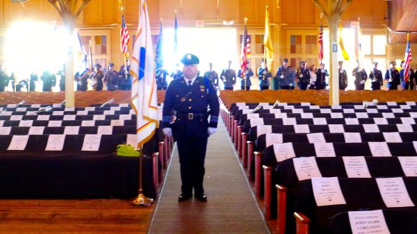Empty seats honor each deceased NJ officer.