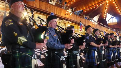 An almost roaring sound made by about 100  bagpipers ringing the Auditorium.