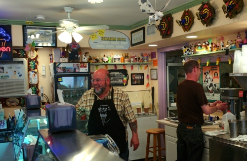 Dave Fernicola and Tom Wilson stretch their scooping muscles on opening day at Days.  PG photo