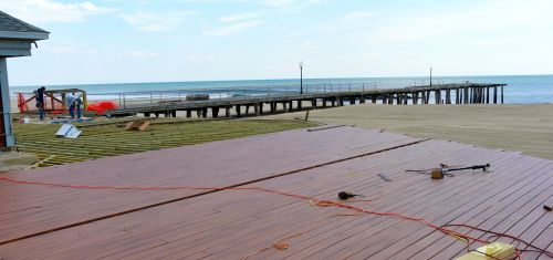 South End boardwalk receiving new composite planks.