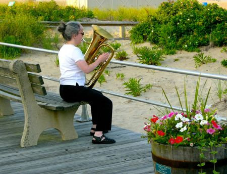 Summer Band musician warming up by the Pavilion.  Paul Goldfinger photo ©
