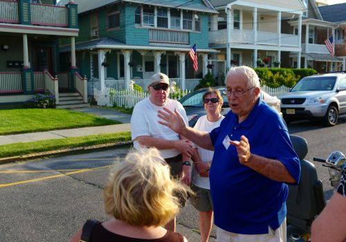 Ted Bell conducts his annual historical walking tour. Here he demonstrates the size of a finial. PG photo
