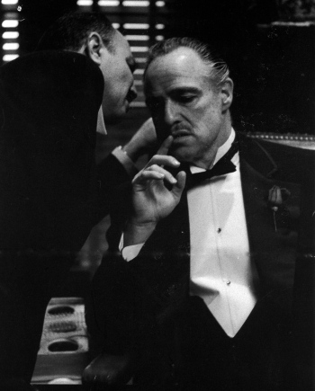 Scene from a Blogfinger editorial meeting.   Photo by Steve Schapiro from The Godfather part I
