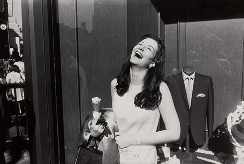 Gary Winogrand.  Beautiful woman eating ice cream cone.