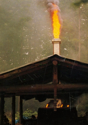 Flames and ash belch out the chimney (Joyous Spring photo)