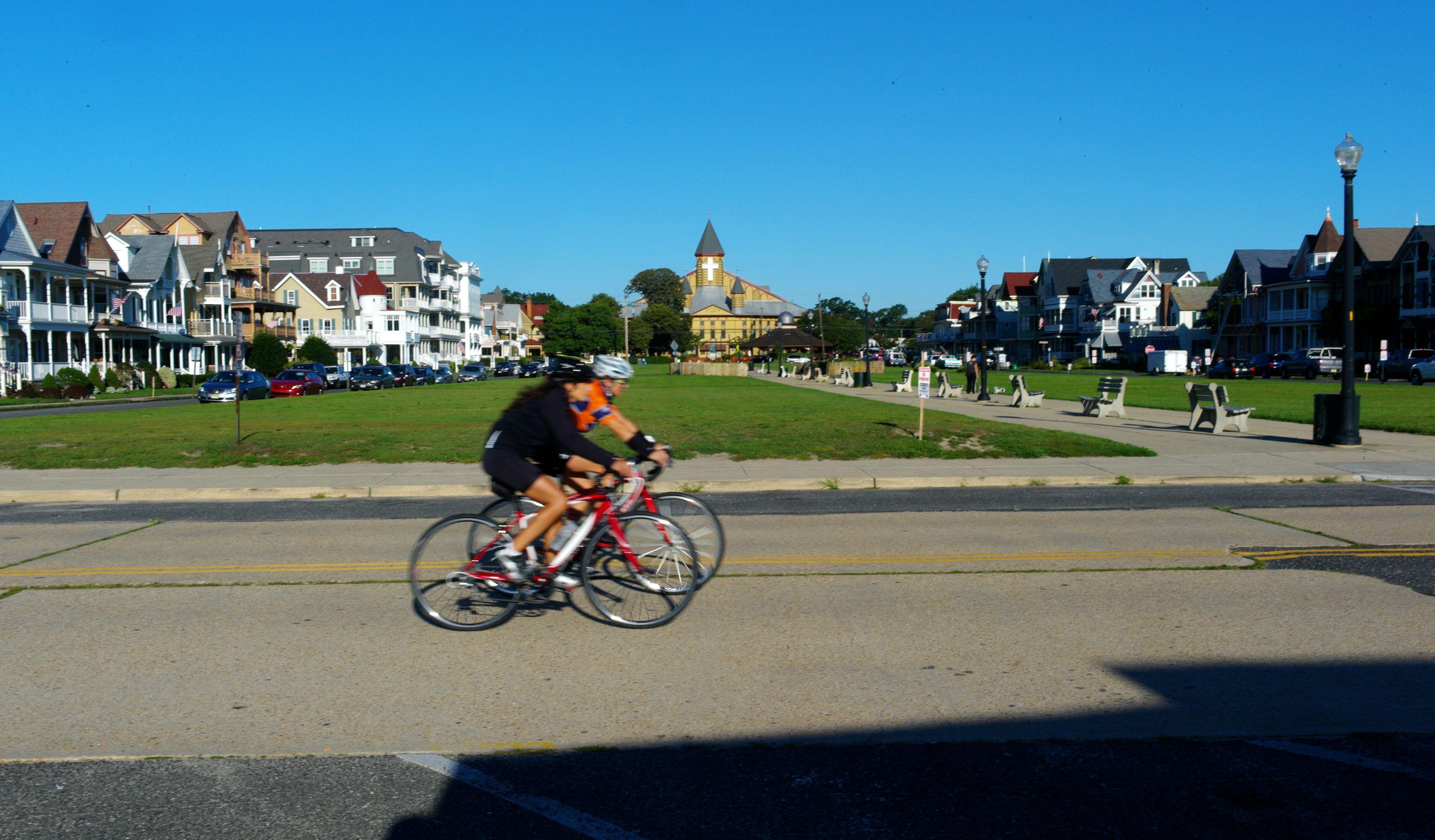 Bikers whiz by an empty Ocean Pathway Paul Goldfinger photo Sept 4 8:30 am ©