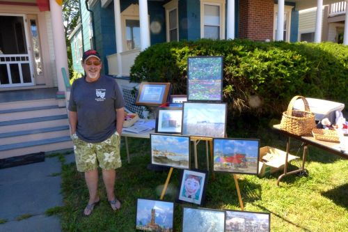 Carl Swenson set up his display  on the Pathway during the Giant Flea Market. He does wonderful house portraits.