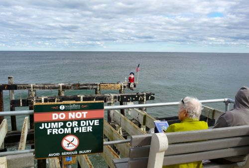 Do you think that anyone contemplating jumping or diving would care what that sign says?  Paul Goldfinger photo  ©