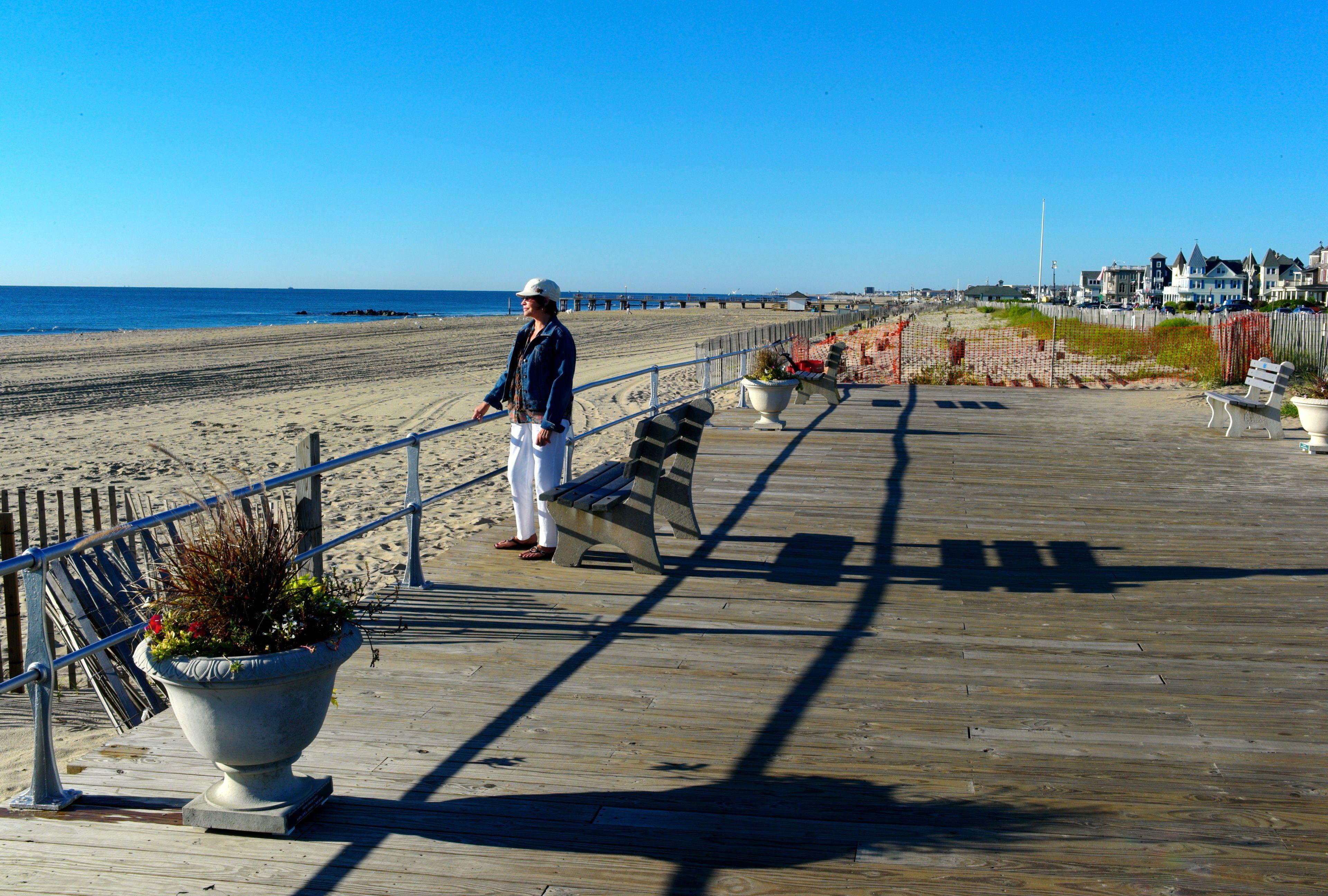8:30 am. Vicky Redfern of Harrisburg, Pa. surveys the empty Ocean Grove beach.