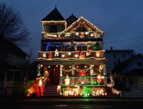 Robin and Ed's house on Abbott between Pilgrim Pathway and New York Ave. It is multimedia, with music and a Santa who jumps out of his sleigh. December 2013. Paul Goldfinger photo ©