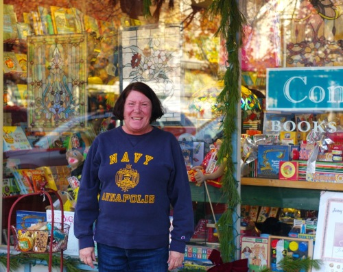 """Liz Ogden on Main Avenue counting her chickens. Her team are the """"Midshipmen"""". © Paul Goldfinger photo. Dec 10, 2015."""