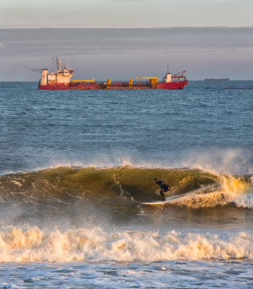 Bob Bowne catches a trawler and a surfer on the Ocean Grove beach. January, 2014 © Special to Blogfinger.
