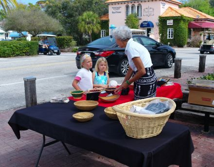 Downtown Boca Grande. While their parents ordered lunch at the Loose Caboose, these sisters strolled across the street to learn beading. ©