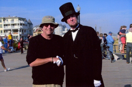 President LIncoln poses for a photo with Paul Goldfinger on the boards of Ocean Grove.