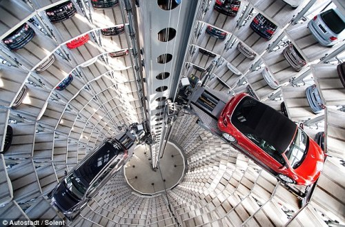 Futuristic garage holds 600 cars in a 200 foot silo.  From the London Daily Mail