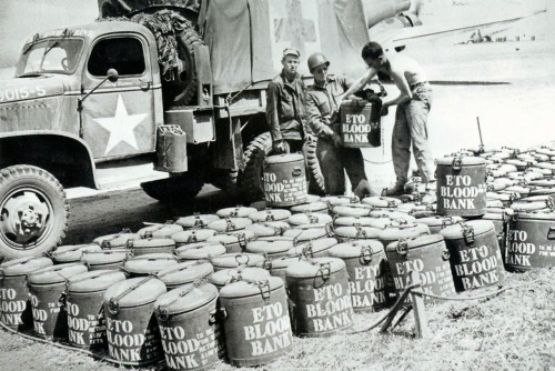 Normandy, a few days after D-Day, aircraft bring in containers of blood for transfusion. *