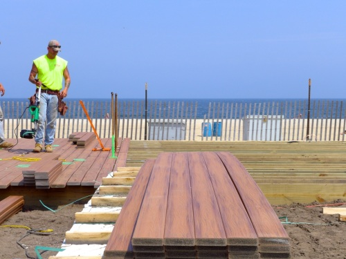 New Trex boards being installed at the Ocean Grove Middle Boardwalk project. June 10, 2014. Paul Goldfinger photo ©