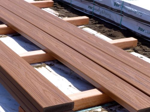 Close-up of Trex boards in the noon sun. They look like wood and they are not dark in color. The color varies with the light. Blogfinger photo ©