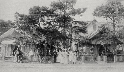 19th century Ocean Grove**  Note the Japanese lanterns hanging from the porch.  Bicycles also  (Look Ma----no locks)