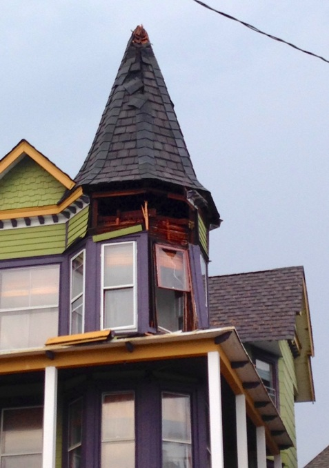 31 Broadway. Looks like the lightning struck the peak and the blew out the roof, walls and windows. WOW  Phil Cappozi   ©