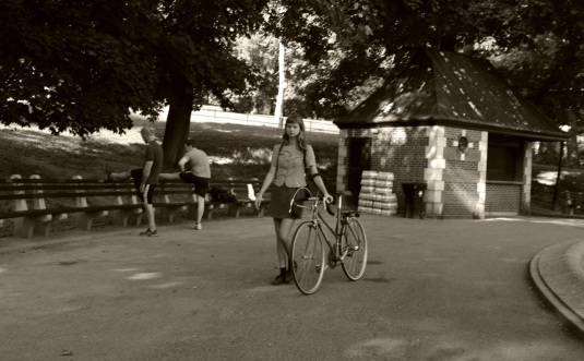 Central Park. August, 2014. Paul Goldfinger photo © NYC Street Series. Click to enlarge and really see her bike.