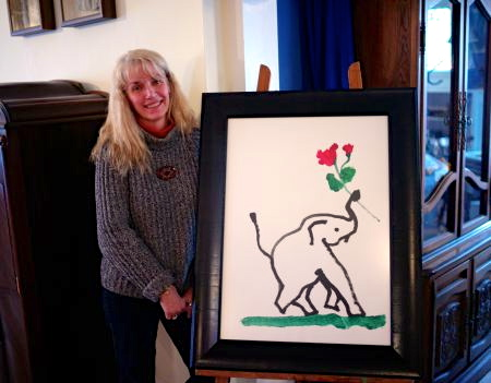 Miss Pegi in the clubhouse. Reposted from our Feb 2014 article.  Blogfinger photo. Painting by an elephant.