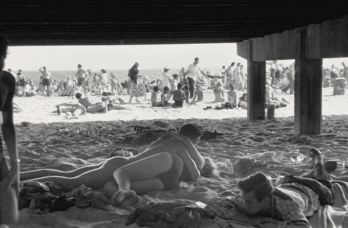 Under the Coney Island boardwalk. c. 1960. By Bruce Davidson ©