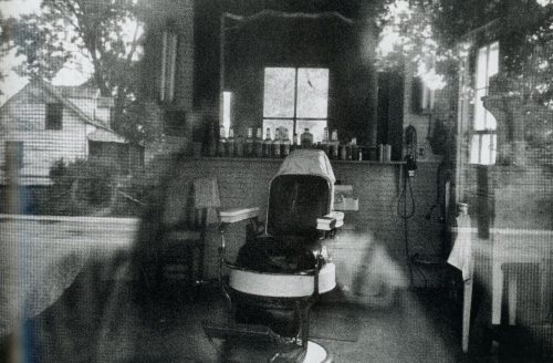 Barber shop through screen door. McClellanville, South Carolina. ©