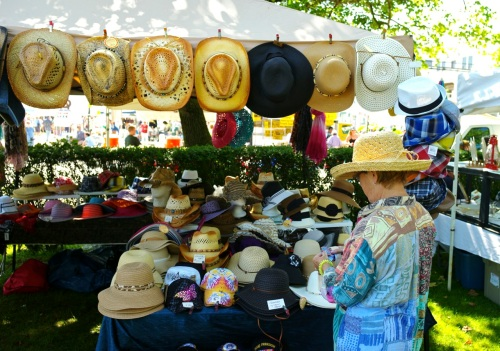 Here's a good time--buying at hat at the OG flea market.  Paul Goldfinger photo ©