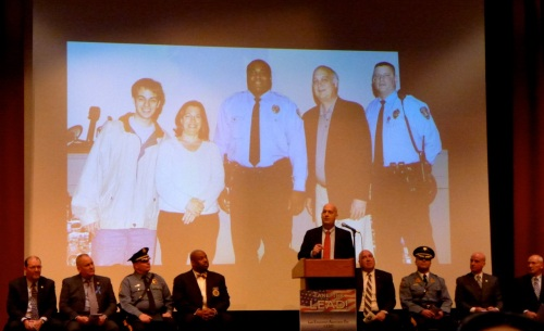Scott Rasmussen spoke of the Neptune Twp. policeman who saved the lives of himself and his family.  Blogfinger photo ©