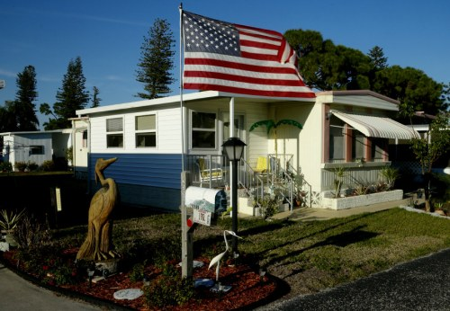 """Tropicana lights. A """"cottage"""" in this 500 unit mobile home park. Ft.Myers, Florida. 2012. Paul Goldfinger photo. ©"""