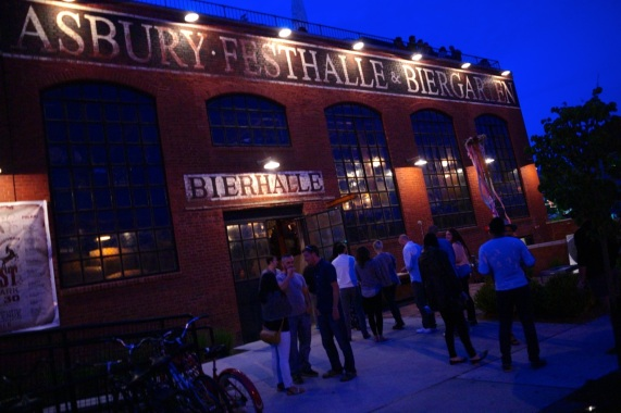 Asbury Bier Hall. This placed was crowded on a Sunday night including patrons on the roof. It was not excessively noisy when we walked by. May 24, 2015. Paul Goldfinger photo ©