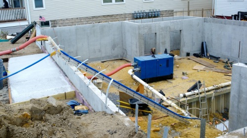 A huge blue pump brings the water out of the elevator shaft seen to the right.