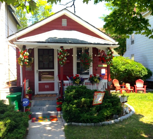 This wonderful cottage was photographed on June 10, 2015 on Broadway.  It is not for sale.   By Paul Goldfinger, Editor @Blogfinger.net  ©