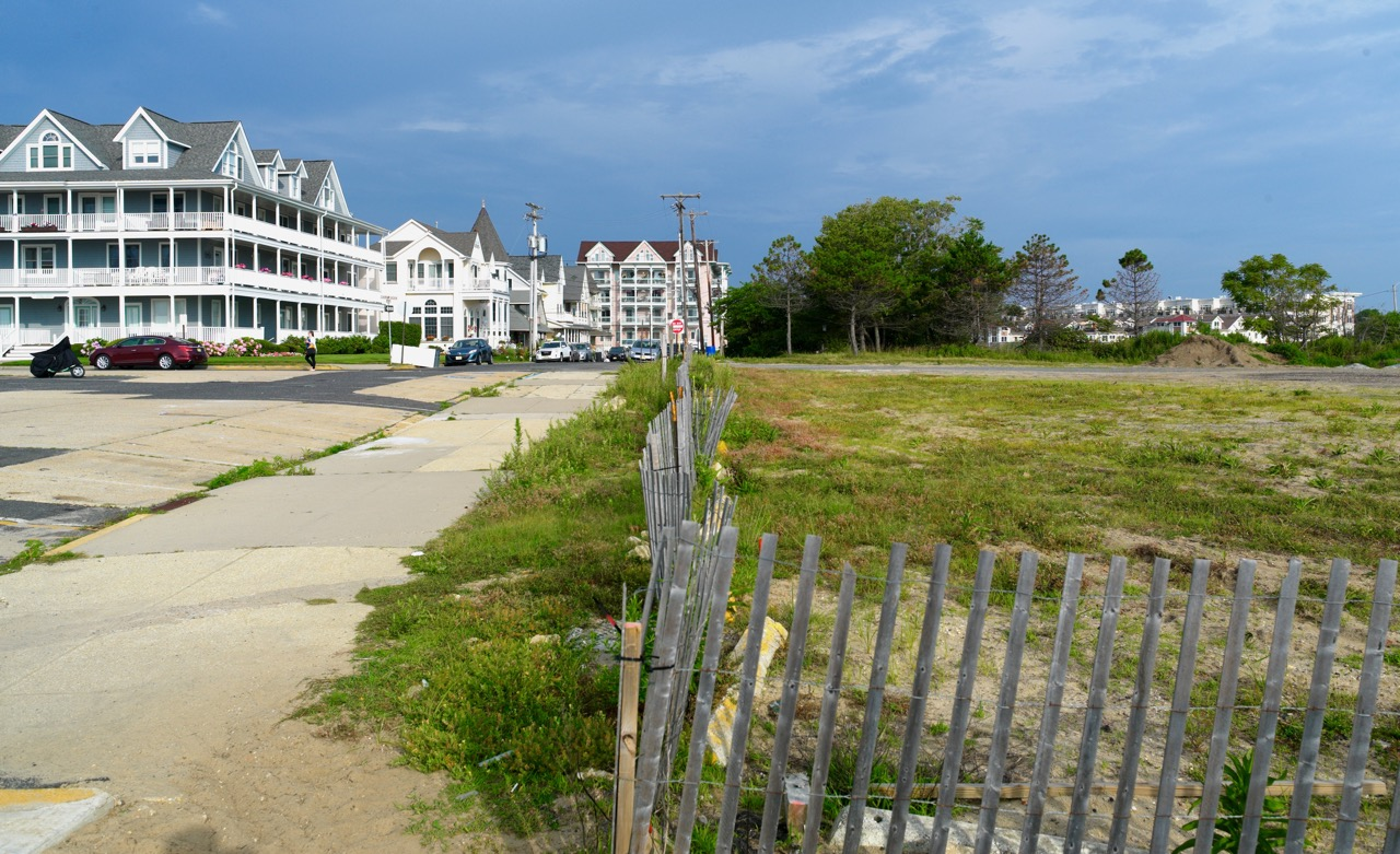 """This view shows the southern edge of the """"blighted area in need of re-development"""". At the lower edge you can see the orange marker.  The hotel (or more condos) will be at that location, with view of the ocean). Further west on Spray will be some single family homes.  Blogfinger photo July 14, 2015 ©"""