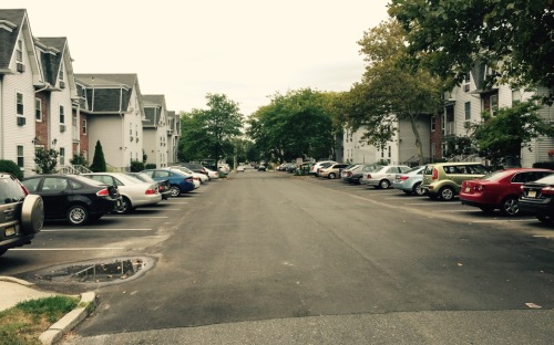 Whitefield Avenue runs down the middle of Embury Arms providing private parking spaces. Blogfinger photo. 9/22/15 ©