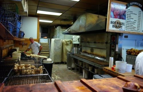 Hot Bagel Bakery. Oakhurst, NJ. Bakers hand roll and bake their bagels in full view of the customers.