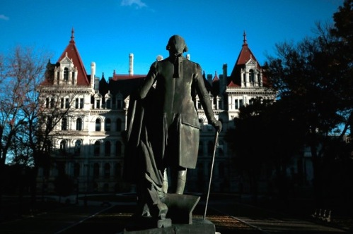 A statue of George Washington in Albany. Two of the most powerful men in the capital, Assemblyman Sheldon Silver and Senator Dean G. Skelos, go on trial this month. Credit Nathaniel Brooks for The New York Times