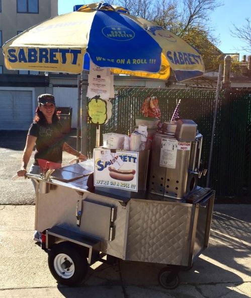 Brigitte Vaccaro serves hot dogs atr the corner of Main Street and Summerfireld, across from the AP Post Office. Nov. 3, 2015. Blogfinger photo ©