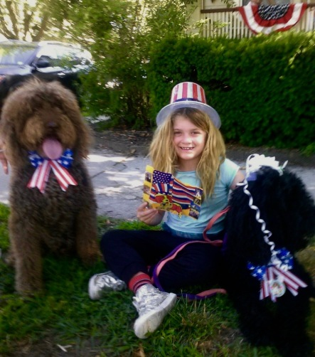 Kylie DeMartine of Ocean Grove celebrates the 4th with two of her closest friends. Chris DeMartine photograph. ©