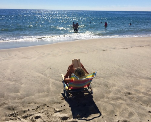 August 23, 2016. Ocean Grove Beach. It's a traditional beach activity---sit in a chair and read a book. Paul Goldfinger photo. ©