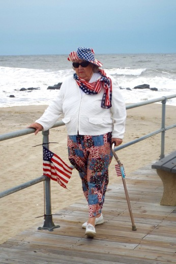 "By Jean Bredin, ""I was impressed by her patriotism in the midst of a gusty morning, while hanging onto the railing for dear life. "" 9/5/16 11100 am. OG pier. Blogfinger staff. ©"