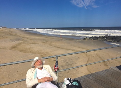 Sunbathing on the pier. Note the Asbury Park jogger heading south on the OG beach while OG citizens are barred. What if that guy decided to jump into the water? Blogfinger photo. 9/4/16 ©