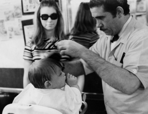 Stephen's first haircut.  Madison Avenue, NYC.  Barber shop just for kids. Paul Goldfinger photo ©