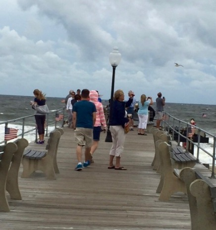 Saturday noon. Skies are darkening; seas are burgeoning. Curious onlookers are out on the pier. Stephen Godfinger photo, Blogfinger staff. 9/3/16